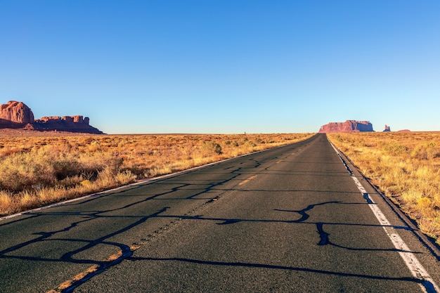 Empty scenic highway (highway 163) leading to monument valley. arizona, usa.
