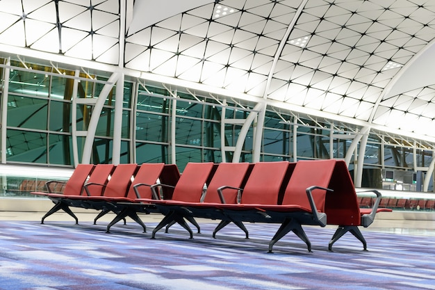 Empty seats for people in the departure area