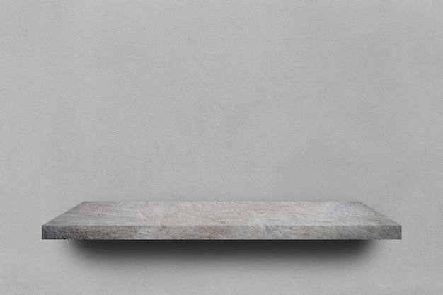 Empty shelf over grey concrete wall background
