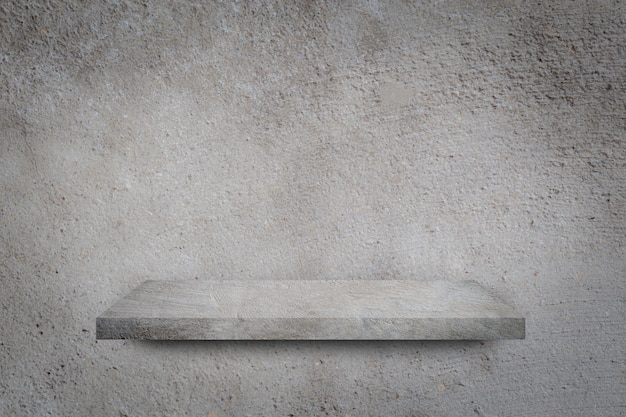 Empty shelf over grey concrete wall