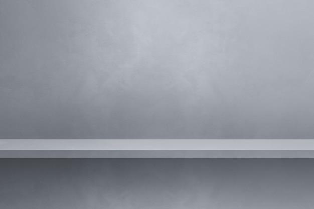 Empty shelf on a grey wall. background template scene. horizontal backdrop
