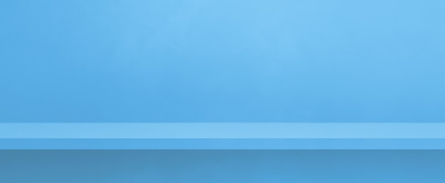 青い壁の空の棚。背景テンプレートシーン。横バナー