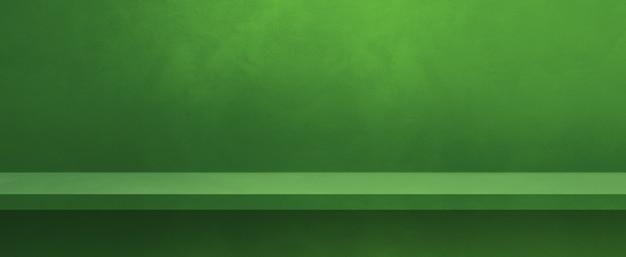 녹색 벽에 빈 선반입니다. 배경 템플릿 장면입니다. 가로 배너