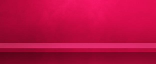 ピンクの壁に空の棚。背景テンプレートシーン。横バナー
