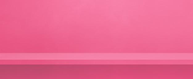 분홍색 벽에 빈 선반입니다. 배경 템플릿 장면입니다. 가로 배너