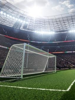 ファンが脚光を浴びているスタジアムでの空のサッカーゴール