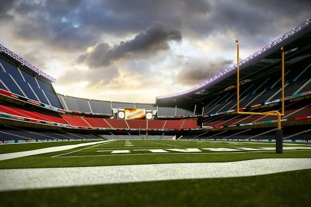 夕方の光の中でファンのない空のサッカースタジアム