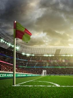 夕方の日差しの中でファンのいない空のサッカースタジアム