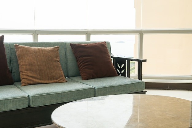 Empty sofa and chair with pillows decoration in a room