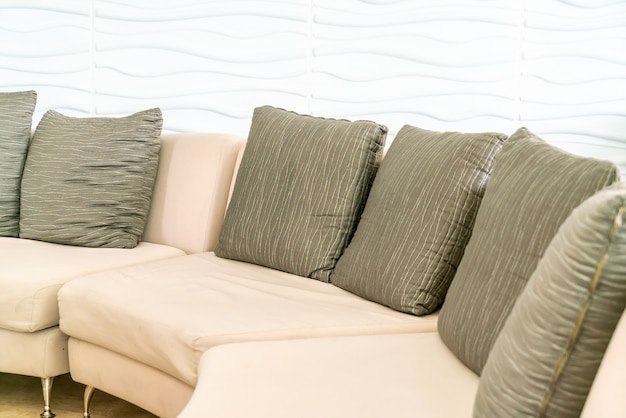 Empty sofa with pillows in hotel lobby