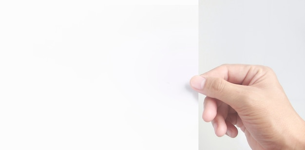 Empty space for text.the hand is holding the white blank paper