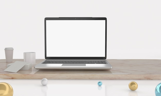 Empty space on wooden desk with laptop with blank white screen.