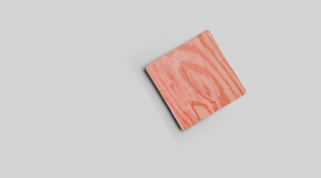 Пустые квадратные горки из пробки, изолированные на сером фоне. идеально подходит для демонстрации еды. Premium Фотографии