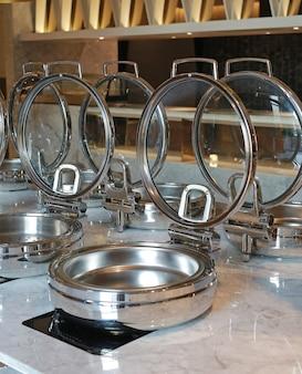 Empty steamer pot on electric stove, smorgasbord.