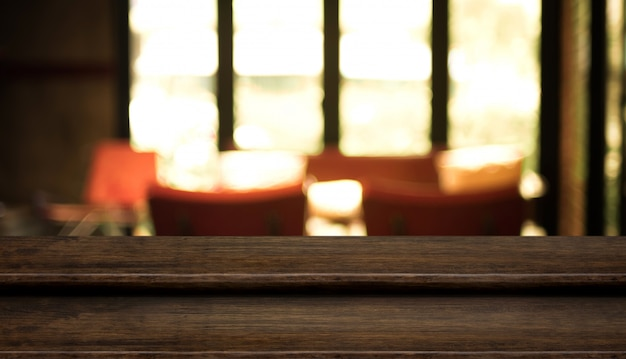 Empty step dark wood table top food stand with blur cafe restaurant background bokeh light