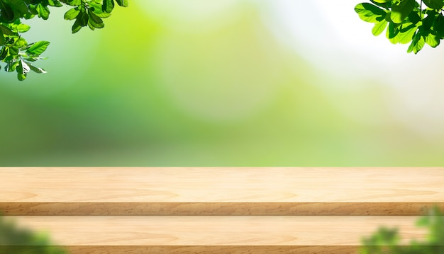 Empty step plank wood table top with blur tree in park with bokeh light background