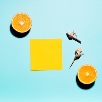 Empty sticker with citrus fruit on light surface