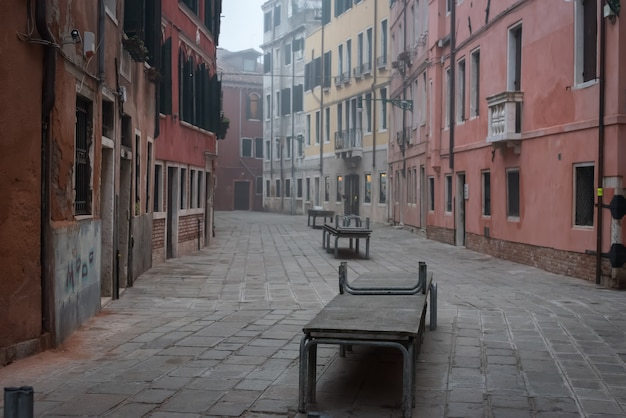 Empty street with anti flood ramps in old town venice, italy