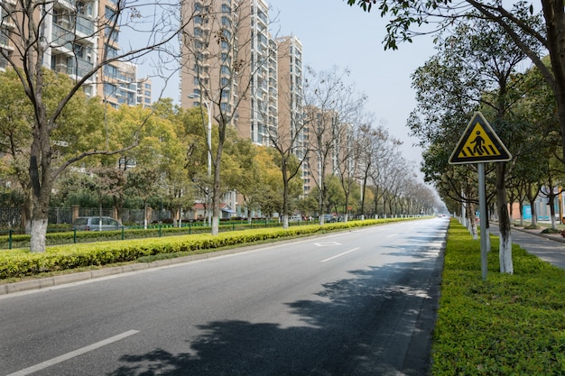 Empty street with buildings and trees