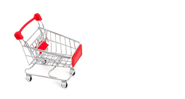 Empty supermarket shopping trolley isolated on white background with copy space