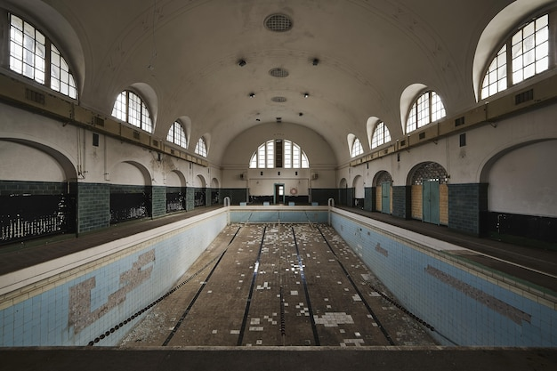 Empty swimming pool inside an old abandoned building