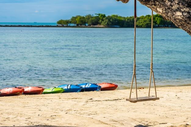 Empty swing seat around beach sea