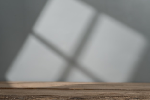 Empty table top for product presentation with window light