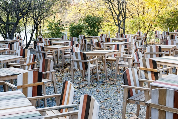 Empty tables and chairs, park restaurant,  cold autumn day