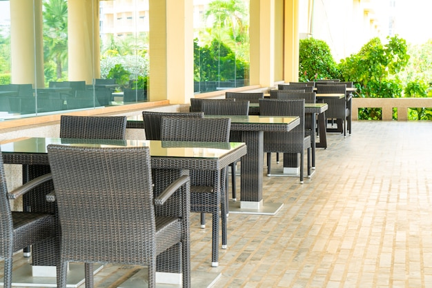 Empty tables and chairs in a terrace