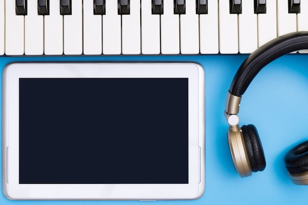 Empty tablet screen with music studio object for music concept