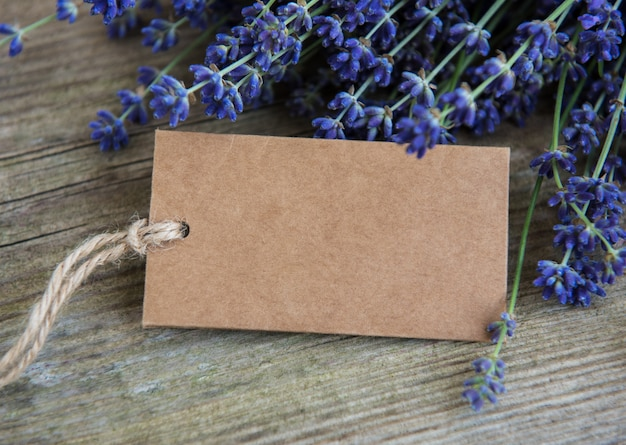 Empty tag and lavender flowers