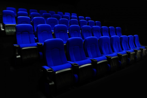 Empty theater auditorium or cinema with blue seats