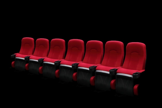 Empty theater auditorium or cinema with red seats one row