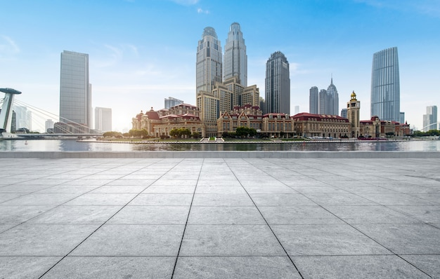 Empty tiled floor and urban skyline,tianjin china.