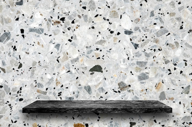 Empty top of black marble stone shelves on terrazzo background