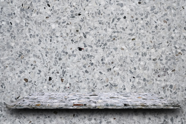Empty top of polished terrazzo stone shelves on terrazzo background