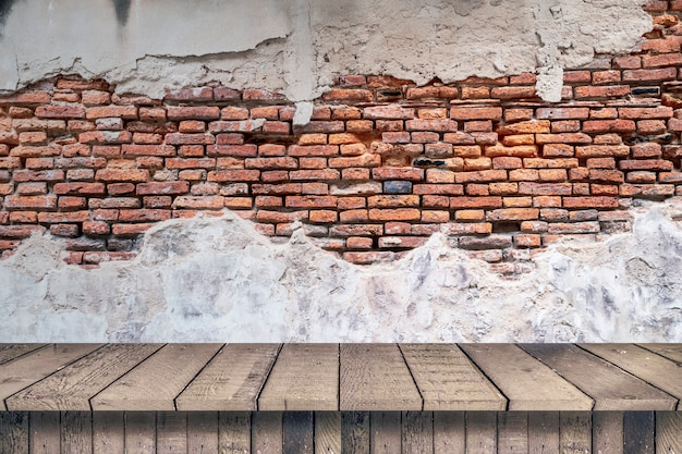 Empty top wood shelves and old brick wall texture background