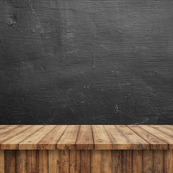 Empty top wood shelves or table on chalkboard wall background.