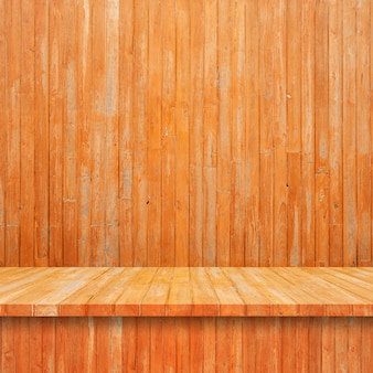 Empty top wood shelves or table on wall background.