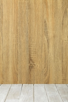 Empty top wooden table and wood wall background