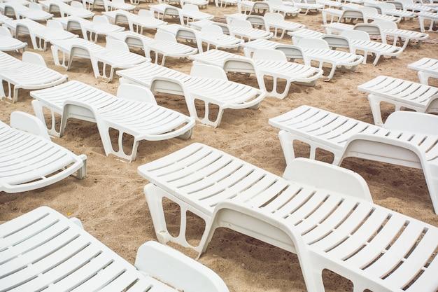 Empty trestle beds on the beach