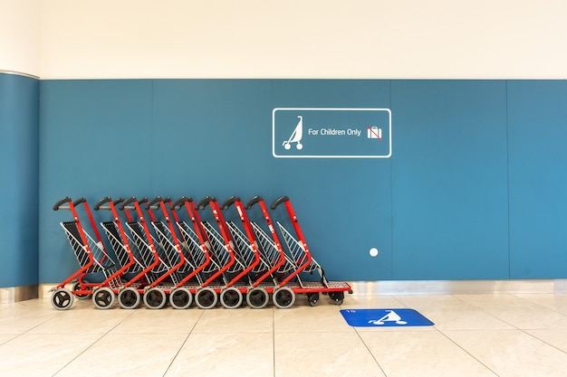 Empty trolleys for a childrens in airport.