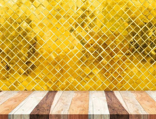 Empty tropical wooden table top at golden mosaic tiles wall,template mock up for display of your product