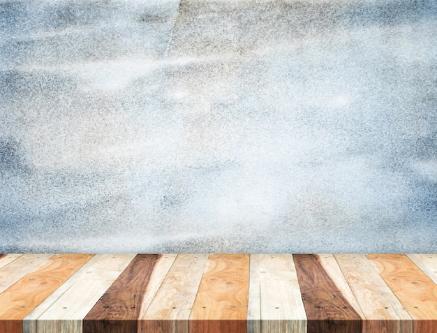 Empty tropical wooden table top at grunge blue stone wall,template mock up for display of your product