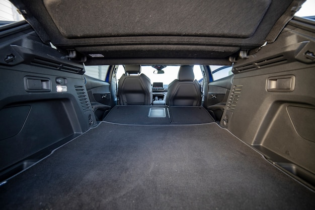 Empty trunk of a modern car with folded rear seats. large interior volume. trunk view