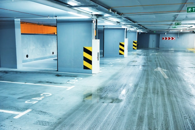 Empty underground parking with lots for cars