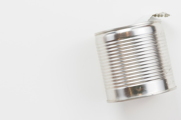 Empty used tin can on white background