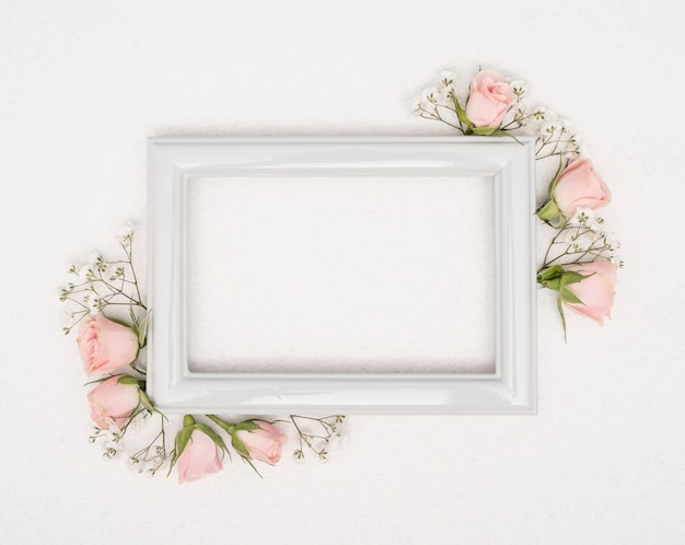 Empty vintage frame with roses buds