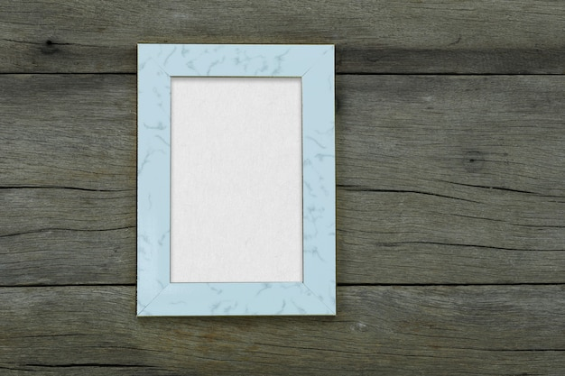 Empty vintage photo frame on old wood