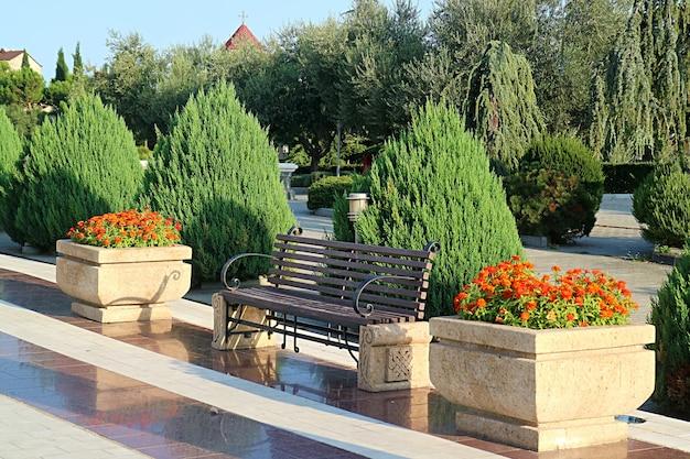 Empty vintage stone bench in a sunshine garden